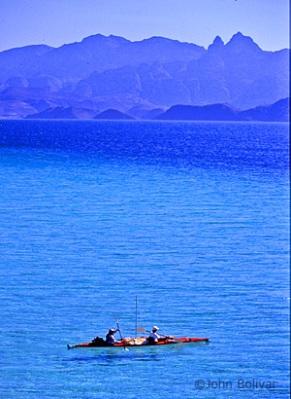 Danzante_kayaking w Isla Danzante in background_photo_John Bolivar_baja_danzante_island_cover