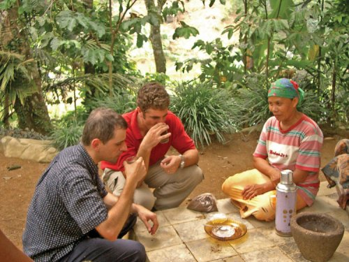 Prof. Marcone and Alun sampling Kopi Luwak in a West Java Village.