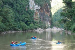 Kayaking through the wilderness. Kuantan River, West Sumatra. Photo: Playak