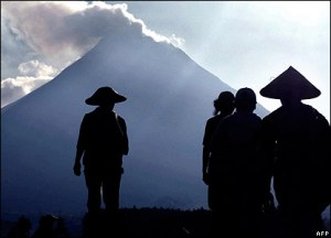 Mt Merapi-Silhouette of farmers against volcanic Mt Merapi in Central Java-www.d.umn.edu