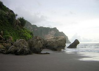 Big boulders amid cliffs jutting out to the sea. Parangtritis beach, Yogyakarta. Photo: www.indonesia-fascination.com