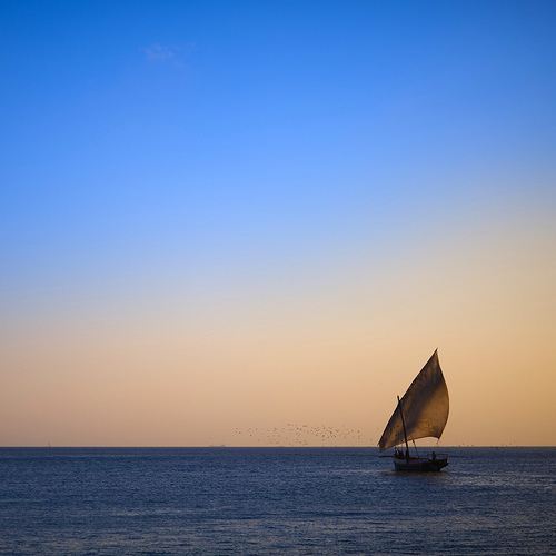 Dhow aginst Sunset-Tanzania-photo flickr member eric laffrogue